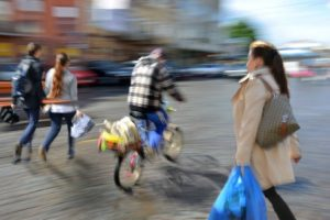 People going along the street. Intentional motion blur